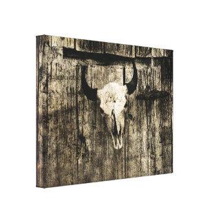 Rustic buffalo skull with horns against barn canvas print