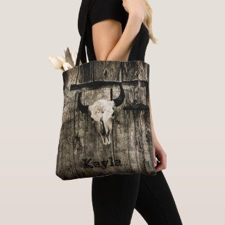 Rustic buffalo skull with horns against barn tote bag