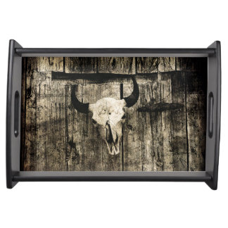 Rustic buffalo skull with horns on a barn serving tray