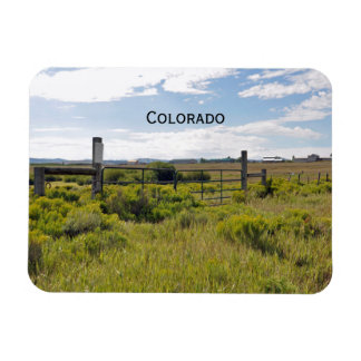 rustic gate and fence by a prairie in Colorado Magnet