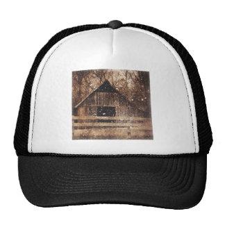 Rustic old barn in winter. trucker hat