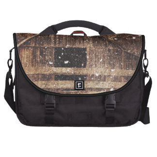 Rustic old barn in winter. laptop commuter bag