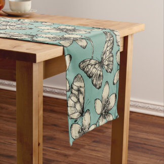 Rustic vintage butterfly and flowers on turquoise