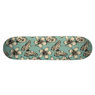 Rustic vintage butterfly and flowers on turquoise skateboard