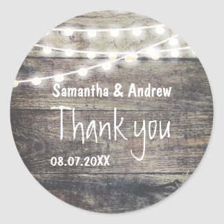 Rustic wood and string lights wedding Thank you Round Sticker
