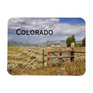 rustic wood fence by a prairie in Colorado Magnet