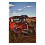 Rusting orange Dodge truck with abandoned farm Poster