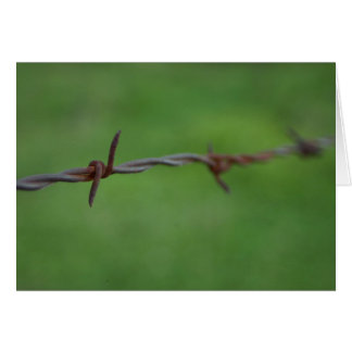Rusty barb wire fence greeting card