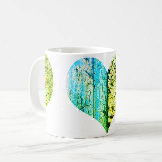 Rusty cracked heart with love coffee mug