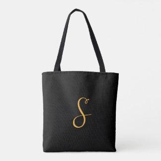 S gold on black monogram tote bag