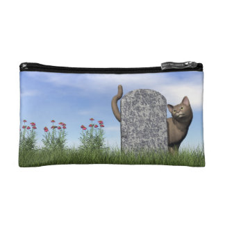 Sad cat near tombstone cosmetic bag