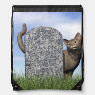 Sad cat near tombstone drawstring bag