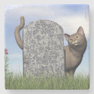 Sad cat near tombstone stone coaster