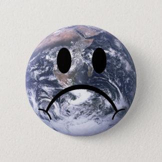 Sad earth badge