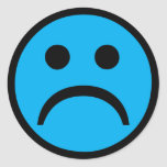 Sad face round sticker