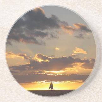 Sail boat at sunset beverage coasters