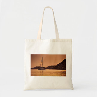 Sailboat Themed, A Boat Approaches The Shore Of Ro Budget Tote Bag