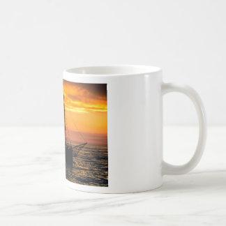 Sailing boat in silhouette at sunset basic white mug