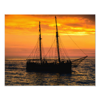 Sailing boat in silhouette at sunset photo print