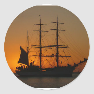 Sailing ship in the sea ,sunset round sticker