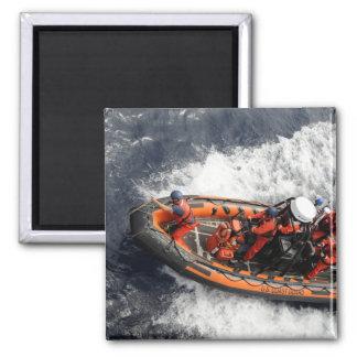 Sailors conducting small boat training magnets