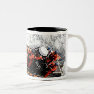 Sailors conducting small boat training mug