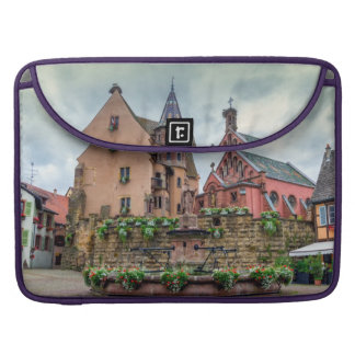 Saint-Leon fountain in Eguisheim, Alsace, France Sleeves For MacBook Pro