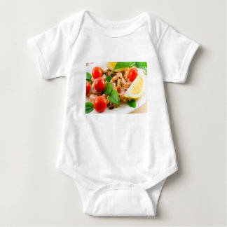 Salad of blanched pieces of seafood on a plate baby bodysuit