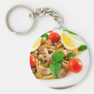 Salad of blanched pieces of seafood on a plate key ring