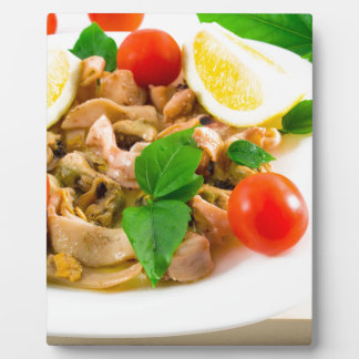 Salad of blanched pieces of seafood on a plate plaque
