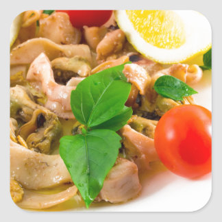 Salad of blanched pieces of seafood on a plate square sticker