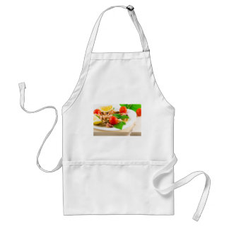Salad of blanched pieces of seafood on a plate standard apron