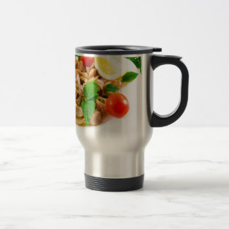 Salad of blanched pieces of seafood on a plate travel mug
