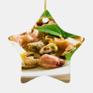 Salad of blanched seafood on a white plate ceramic ornament