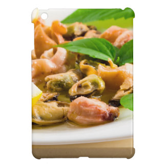 Salad of blanched seafood on a white plate cover for the iPad mini