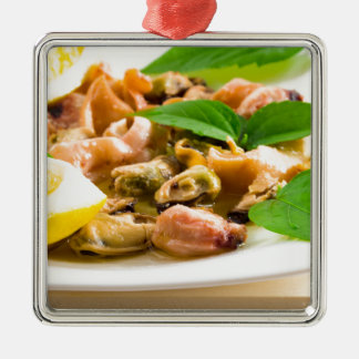 Salad of blanched seafood on a white plate metal ornament