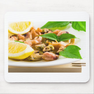 Salad of blanched seafood on a white plate mouse pad
