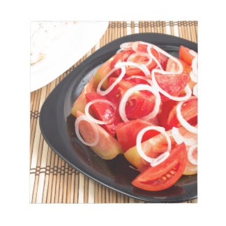 Salad of red and yellow tomato notepad