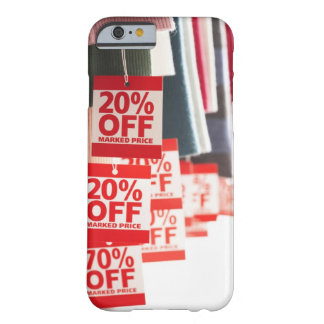 Sale tags attached to hanging clothes, close-up barely there iPhone 6 case