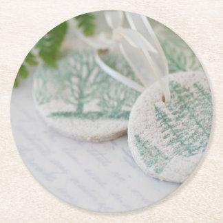 Salt dough tree ornaments on vintage letters round paper coaster