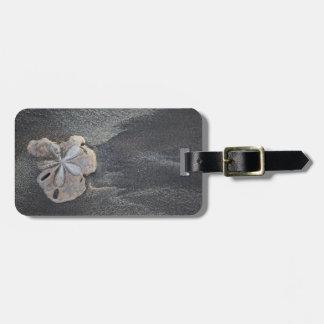 Sand dollar on sand luggage tag