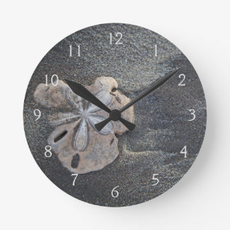 Sand dollar on sand round clock