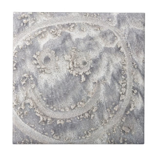 Sand drawing. Sunny smiley face on the beach Small Square Tile
