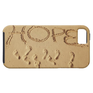 Sand writing ' Hope' on the beach with the Tough iPhone 5 Case