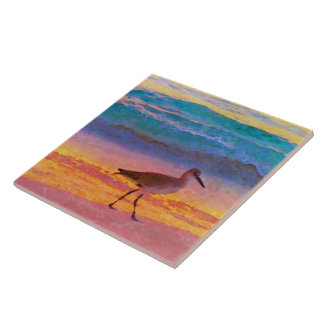 sandpiper on beach at sunset ceramic tile