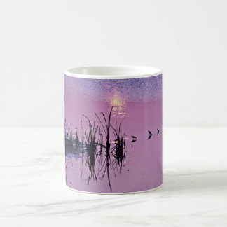 Sandpipers in the sunset coffee mug