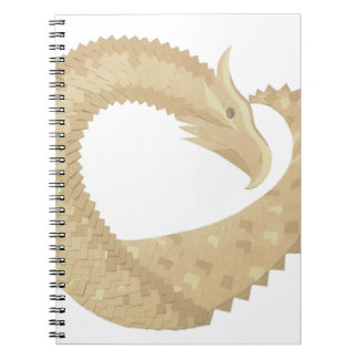 Sandstone heart dragon on white notebook