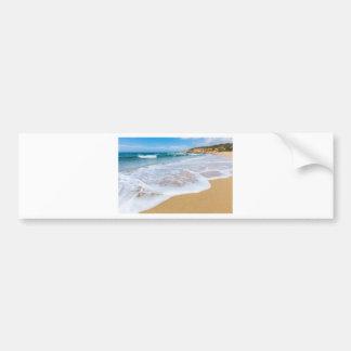 Sandy beach sea waves and mountain at coast bumper sticker