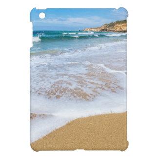 Sandy beach sea waves and mountain at coast iPad mini covers
