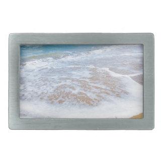 Sandy beach sea waves and mountain at coast rectangular belt buckle